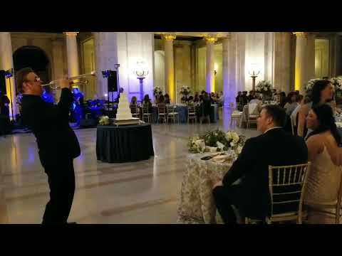 MIKE FISHER PLAYING A TRUMPET SOLO FOR THE NEWLYWEDS AT THE COURTHOUSE IN CLEVELAND,OHIO