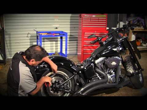 How to install seat bolts on a Harley Davidson.
