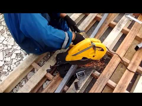 Cutting 45 degree miter on steel square tubing with steel cutting saw.