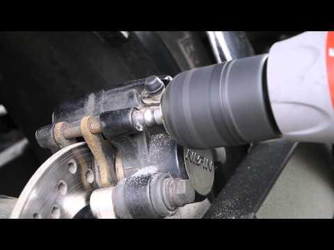 Removing a stuck caliper pin cover
