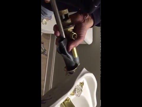 One way to remove a stuck bath sink drain flange