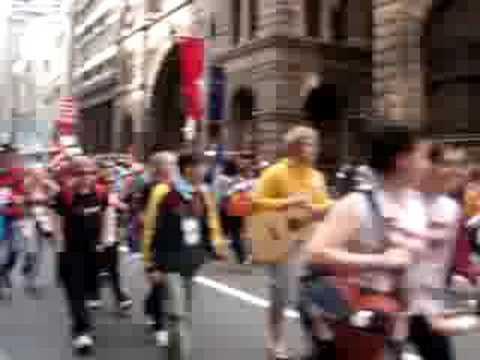 Pilgrims walk the street of Sydney.