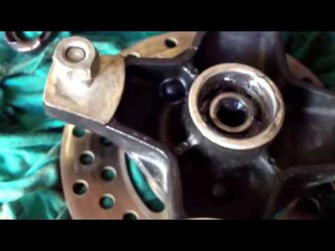 How to grease front wheel bearings on most ATV Four Wheeler