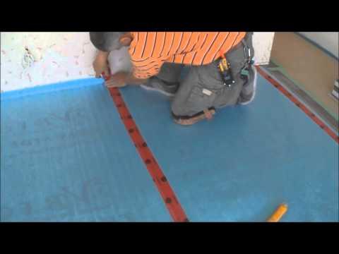 Installing the Underlayment for Laminate Flooring Installation on Wood Mryoucandoityourself