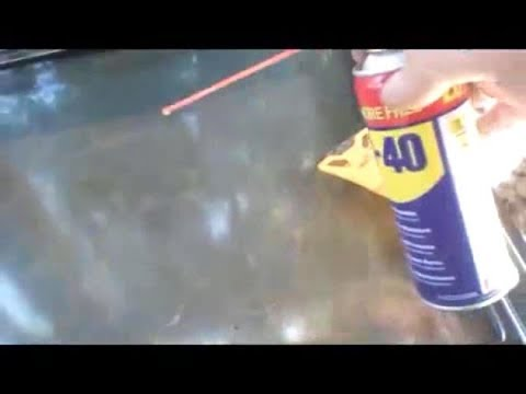 Cleaning the Oven Door Glass with spray lubricant WD-40