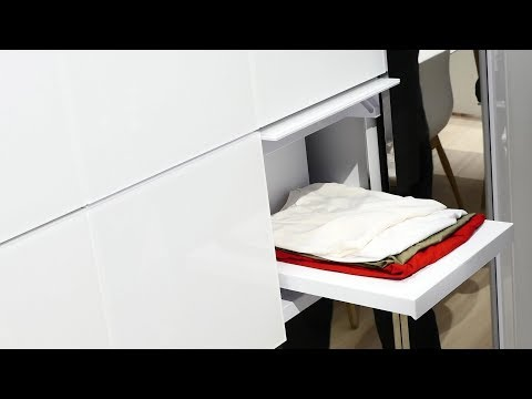Panasonic presents a washing machine that folds your clothes and a fridge that comes when called