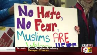 Dozens gather at CVG to protest immigration ban