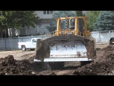 CAT D8T Bulldozer moving dirt around on a construction site building a new school
