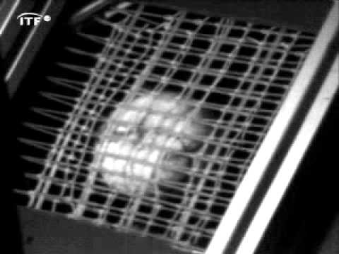 Tennis racket with spaghetti strings inpacting tennis ball