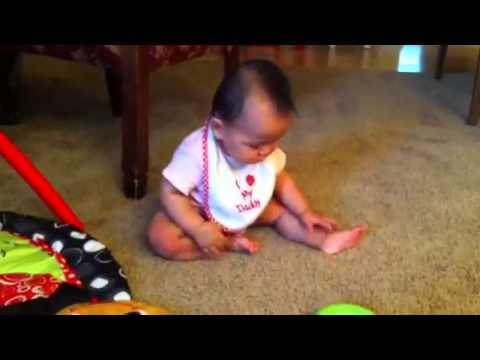 baby goes from crawling position to sitting position