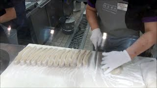Hong Kong Street Food. Cooking Fried Loaves of Bread. Action in the Kitchen of a Chiense Restaurant