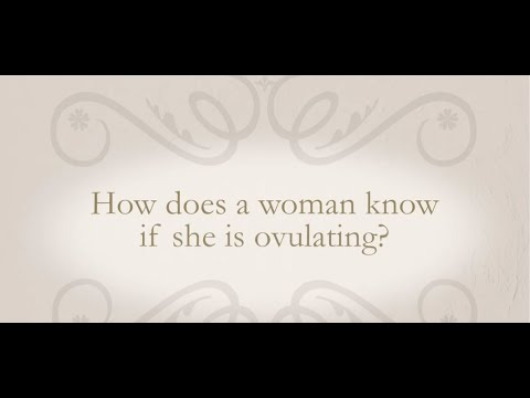 How does a woman know if she is ovulating?