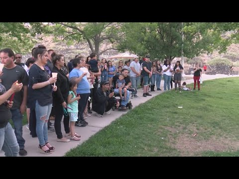 Family, friends hold vigil for double homicide victims