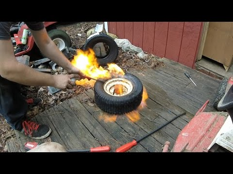 Changing Lawn Mower Tires with Hand Tools