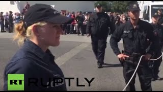 Germany: Far-right protesters boo Merkel as she departs Heidenau refugee centre