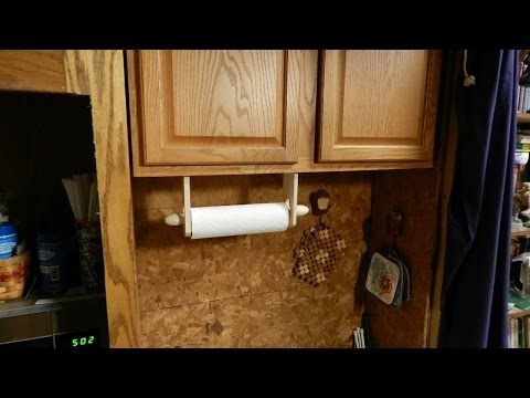 A simple wooden paper towel holder.