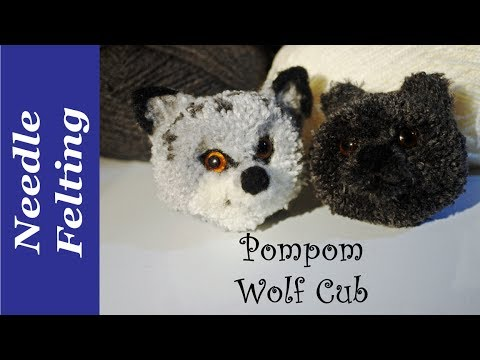 Pompom wolf cub. A needle felted pompom dog
