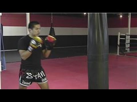 Kickboxing Training : Hitting the Punch Bag