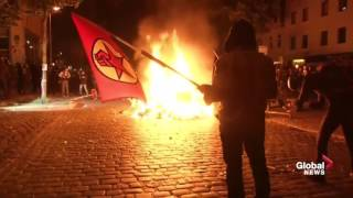 Fire burns on Hamburg, Germany street as G20 protesters clash with police