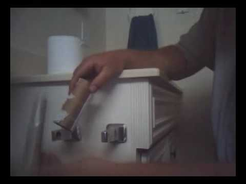 changing a toilet paper roll