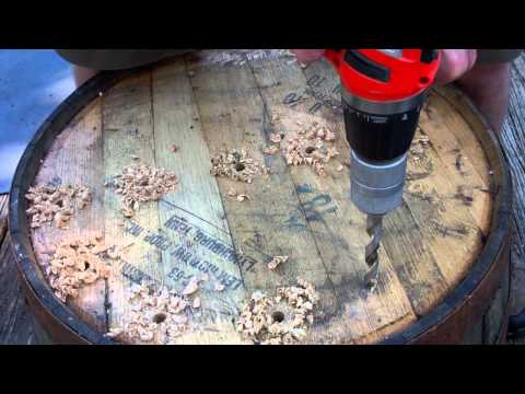 Drilling Drain Holes every 4 inches in JD Half Whiskey Barrel