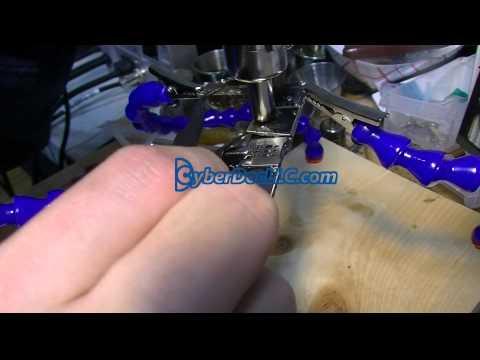 Desoldering iphone 6 logicboard metal frames with Soldering helping hands 4X
