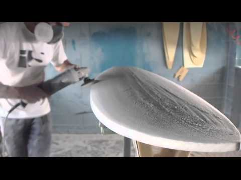 Hand shaping a surfboard from a blank