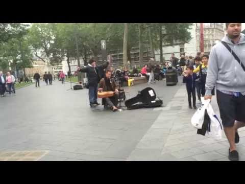 London street performer fights homeless man