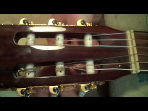 How to put strings on a classical guitar - How to change your guitar strings - Nylon