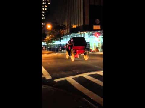 NYC carriage driver illegally GUNNING IT through red light in dangerous traffic!
