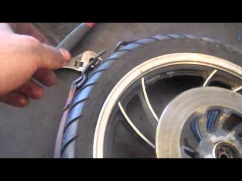 How to bead a tire using ratchet strap