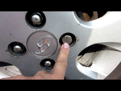 How to remove the dust cap off a locking wheel nut and bolt