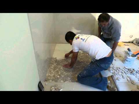 Shower floor pebble stone time lapse.