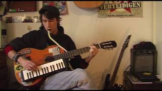 Playing guitar and melodica at the same time (introducing the melogitar)