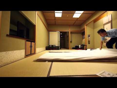 Making up a futon bed at Japanese traditional Ryokan