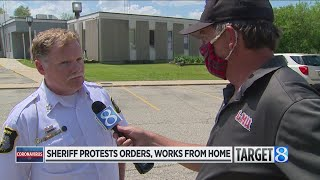 Sheriff who protests governor's stay-home order stays home to work