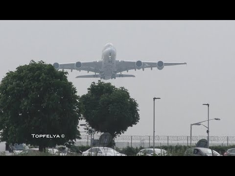 What a thriving view ! Heavy Airplanes A380 and Boeing 747 taking off