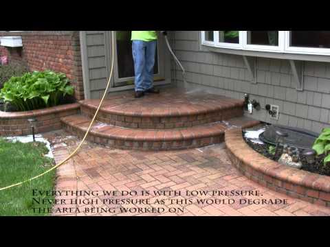 Power washing brick paver walkway to remove dirt