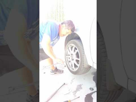 Removing your wheel lug nuts with a breaker bar & pipe