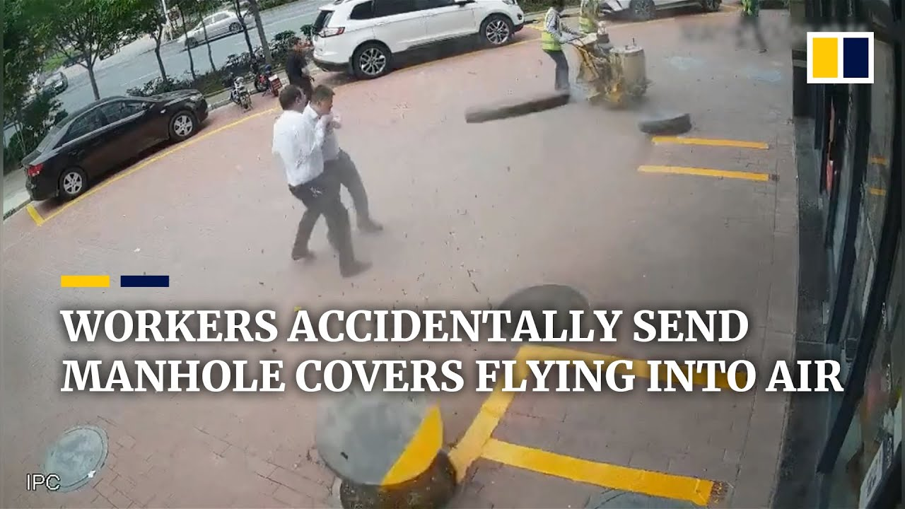 Chinese workers accidentally send manhole covers flying into air