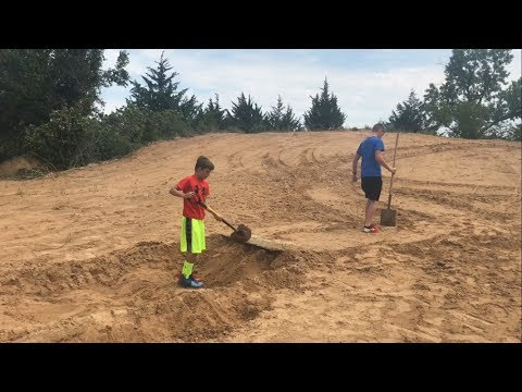 Building a bike ramp on the old sand hill!