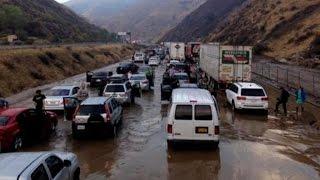 Mudslides trap hundreds of cars on major Calif. freeway