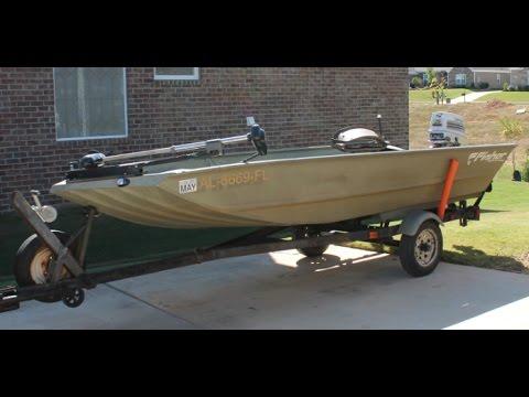 Fisher 1448 All Weld Jon Boat with 25 hp Johnson Tiller Steer Outboard Motor