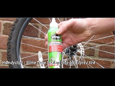Putting Slime tube sealant into MTB bike tyre / tire