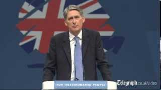 Philip Hammond is heckled by angry veterans during party conference speech
