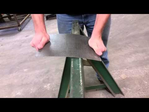Straightening perforated steel.