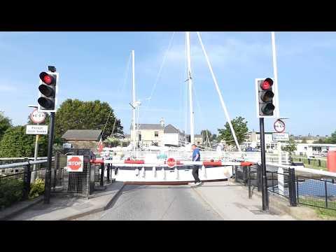 Boats entering Glasson Dock lock complex Lancaster England UK