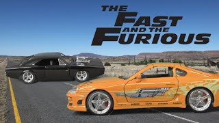 Fast and Furious 7 Twin Pack Dom's Charger (Black) and Brian's Supra (Orange) from Jada Toys