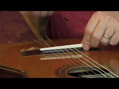 Adjustable saddle for classical guitar