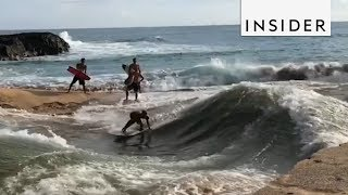 surfers make an infinity wave pool by hand